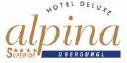Hotel Alpina und Skigebiet im Winter